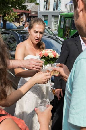 drank: Bride with friends drank champagne from plastic cups in town