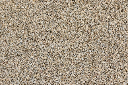 factions: Texture of pea gravel of different factions brown horizontal orientation