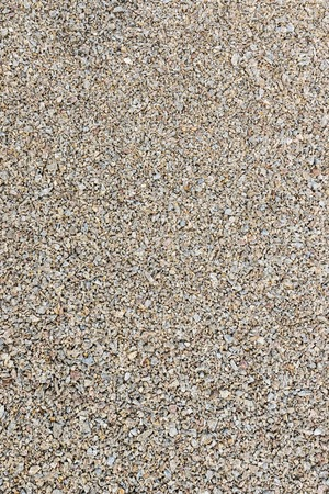 factions: Texture of pea gravel of different factions brown vertical orientation