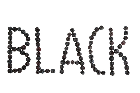 black raspberries: Been laid out black raspberries spell the word Black isolated on a white background