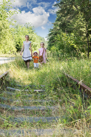 three sisters: Three sisters goes on camera by railway in the woods