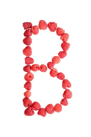 studio b: Laid ripe red raspberries letter B isolated on white background