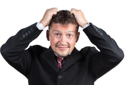 in tears: Hombre de negocios en traje y corbata expresar emociones negativas desgarrando su pelo aislado en el fondo blanco Foto de archivo