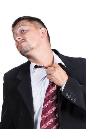 head back: Businessman loosens his tie around his neck taking his head back isolated on white background