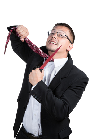 demotion: Man in suit and glasses knife cuts off his tie isolated on white background