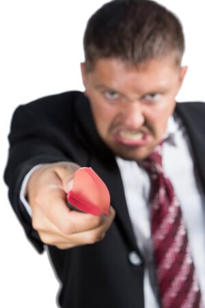 stabs: Angry man in a suit blurred knife stabs to the camera isolated on a white background Stock Photo