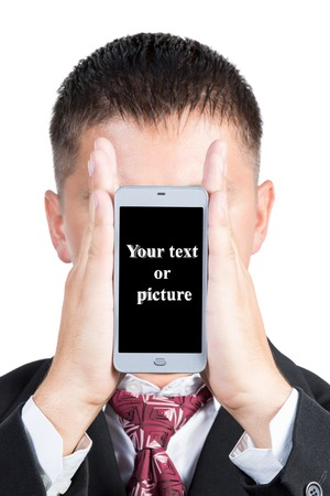 your text: Man holding your smartphone with both hands in the face of a black screen outside for your text or images isolated on white background
