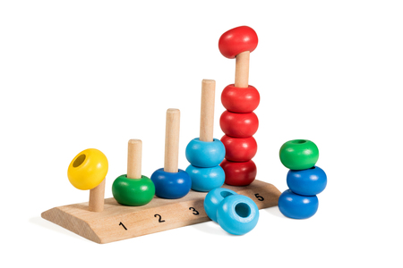 scores: Colorful wooden children toy scores from one to five of the colored rings demounted isolated on a white background