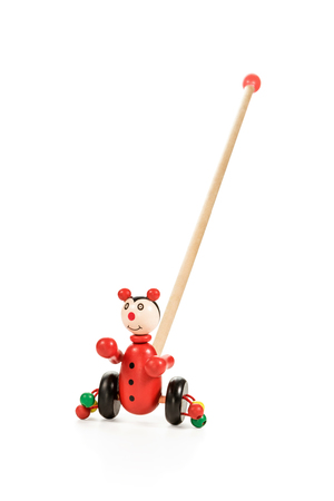 ni�o empujando: Red wooden  rolling toys clown on wheels with a stick and balls for little kids isolated on white background