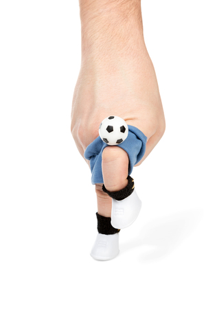 juggling: Imitation with your fingers football players juggling the ball using knee isolated on white background Stock Photo