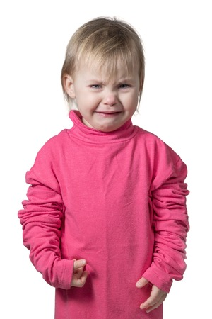 sad cute baby: Small child in a crimson blouse large size bitterly crying isolated on white background