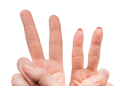 sign up: Female and male hands counting number two isolated on white background Stock Photo
