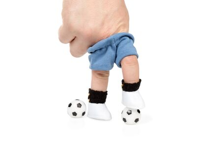 stepped: Footballer of the fingers dressed in football uniforms stepped on the ball and another is near the ball isolated on white background