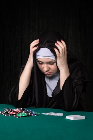 lost money: Nun grabbed his head lost all the money in the poker