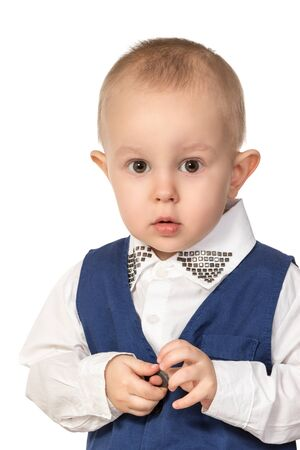 protruding: Close-up portrait of a little boy with protruding ears in the blue formal suit isolated on white background Stock Photo