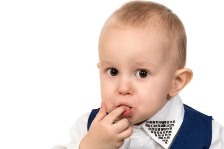 eat smeared baby: Close-up portrait of a little boy a mouth full of of crumbs and stained lips isolated on white background