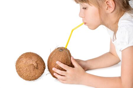 drank: Girl holding a coconut and drank water from it through a straw isolated on white background