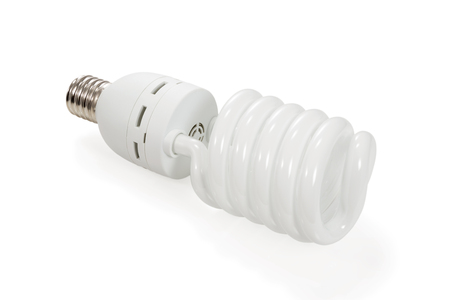 economical: Economical energy saving spiral fluorescent lamp isolated on white background