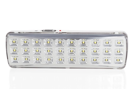 plurality: LED luminaire of a plurality of lamps with the switch and charging indicator isolated on a white background