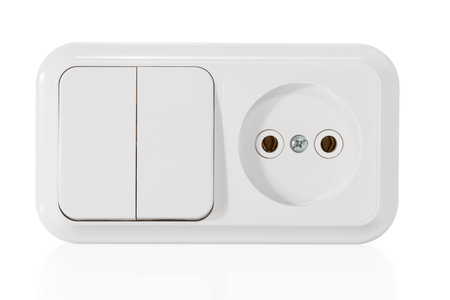 switch: Unit from the electrical outlet and dual-switch close-up isolated on white background Stock Photo