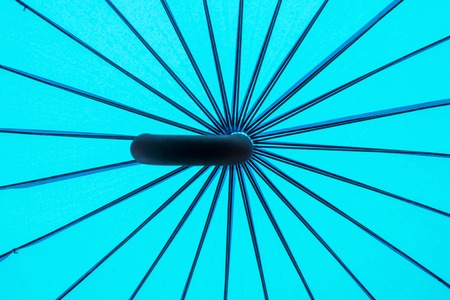 Background of turquoise umbrella with spokes bottom view Stock Photo