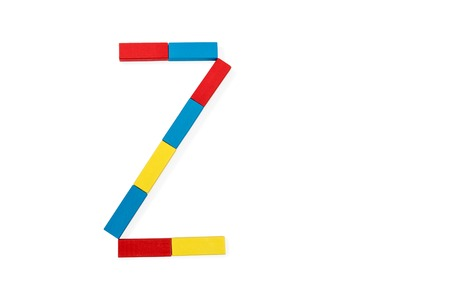 Capital letter Z made up of different color wooden rectangular blocks isolated on a white background Stock Photo
