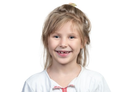 Portrait of a beautiful smiling child girl with no front teeth isolated on white background Stock Photo