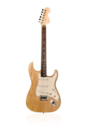 Beige wooden electric guitar with volume controls and tone isolated on white background Stock Photo