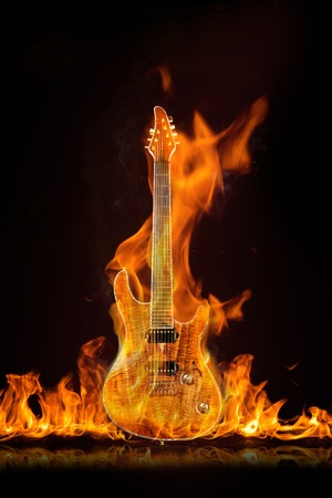 Beautiful seven-string guitar on fire on a black background Reklamní fotografie