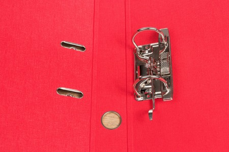 Empty open red folder for papers with a metal clip, close-up