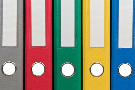 group  accountant: Multi-colored office folders to store documents standing next to each other, close-up Stock Photo