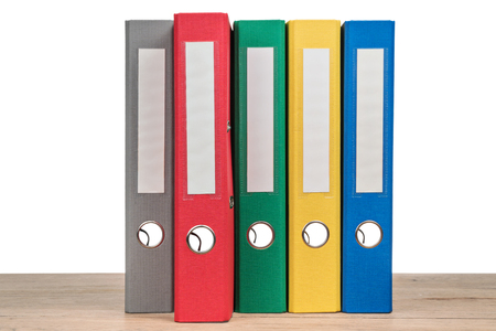 Multi-colored office folders to store documents standing next to each other, close-up Stock fotó