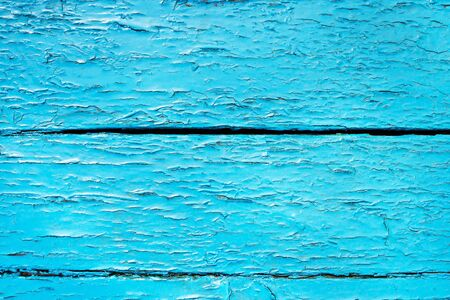 of irradiated: Texture of an old wooden board painted in blue with an irradiated paint Stock Photo