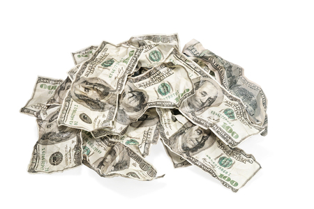 Big pile of rumpled money isolated on white background