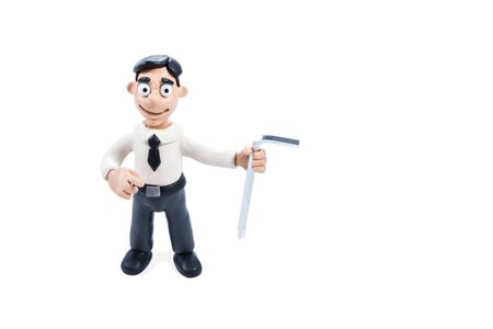 Plasticine businessman in shirt and tie with a corner screwdriver in hands isolated on white background Stock Photo