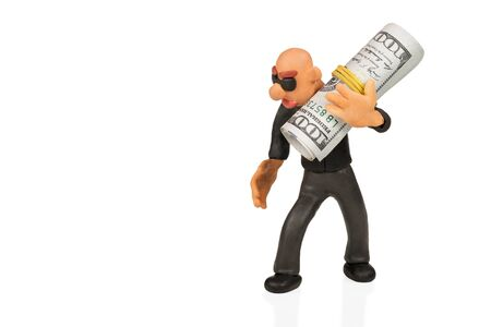cash: Bald plasticine man with glasses carries on his shoulder a bundle of dollars isolated on a white background