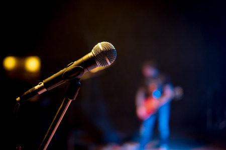 Classic microphone on the stand at a concert in the dark