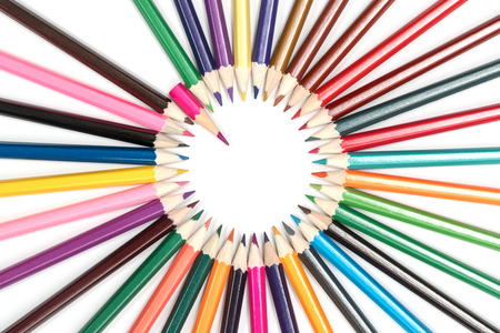 Circle of pencils, sharpened side in the center with a pointer in the form of a short pink pencil