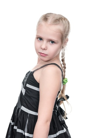 Portrait of little girl in dress turned on camera isolated on white background Stockfoto