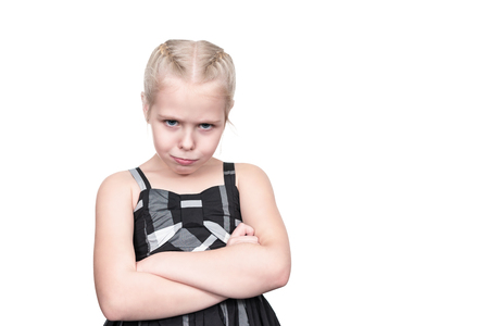 Portrait of the offended young girl with pouty lips, isolated on a white background Stock Photo