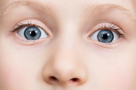 Blue eyes with long eyelashes looking at the camera close-up