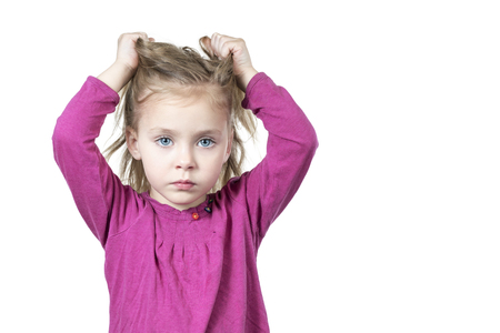 Little beautiful sad girl pulls her hair isolated on white background Stok Fotoğraf