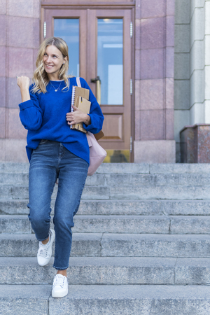 joyful student runs the stairs and exults that she passed the exam Stok Fotoğraf