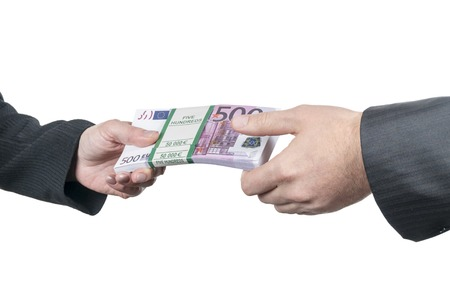 female hand stretches out to male hand a big wad of euro money isolated on white background Stock Photo