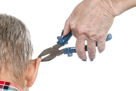 Female hand holding a pair of pliers for a man ear, close-up, isolated on a white background Stock fotó