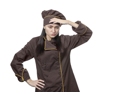 Portrait of a disgruntled pensive chef in brown uniform isolated on white background Stock Photo