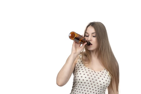 beautiful woman drinking from bottle with closed eyes isolated on white background Reklamní fotografie