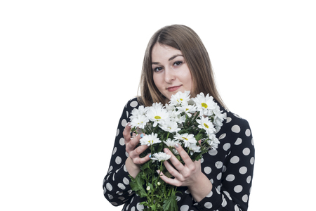 portrait of beautiful business woman gently hugging a bouquet of flowers isolated on white background