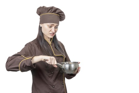 chef looking with disgust at the pot in his hand isolated on white background