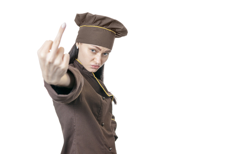 displeased chef showing middle finger at camera isolated on white background